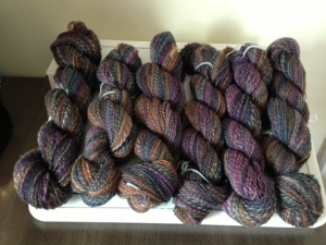 Here we have about 1200 yards of 2-ply.  Spun from 2 4-oz braids of hand-dyed BFL from Frabjous Fibers in the Cathedral and Potash colorways.