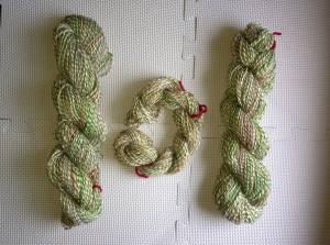 3-ply. 2 strands of silver Romney/Perendale. 1 strand of hand-carded red/green/natural Romney.  360 yds.