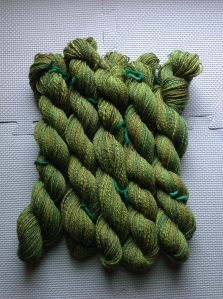 "Sweet Georgia ""woodland"" 75% BFL/ 25% silk. 2 4-oz braids. 3-ply. About 1000 yds, give or take a few."