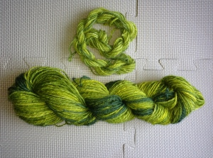 "5 oz of Julie Spins ""Asparagus"" Wensleydale. Chain ply/3-ply. 170 yds."