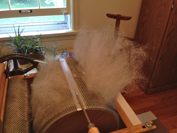 Separating the fiber from the carder.