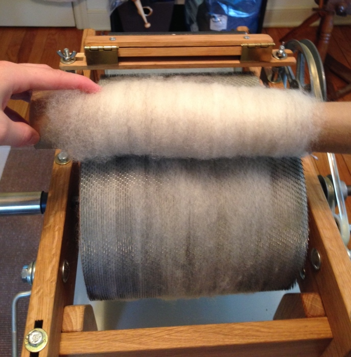 Rolling fiber off the carder using a handy-dandy paper towel tube.